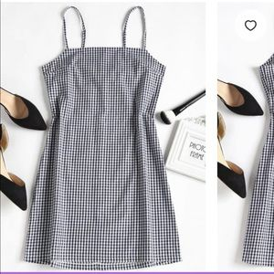 Casual mini dress with a plaid pattern.